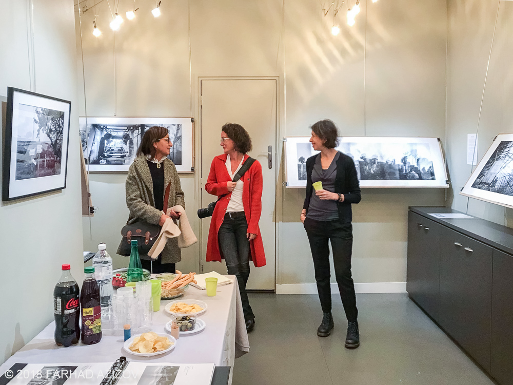 "Elise Prudhomme (middle) and guests during opening night of the photography exhibition ""Lieux-dits"" at Studio Galerie B&B in Paris, France."