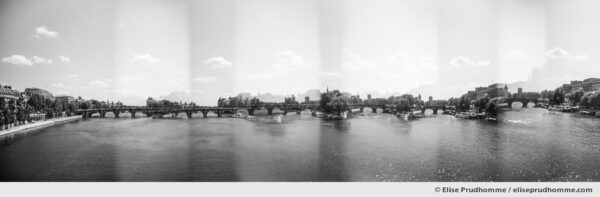 Black and white panoramic photograph of Ile-de-la-Cite, the Seine River and Pont Neuf, Paris, 1st arrdt, France. Analog photography series entitled Lieux-dits by Elise Prudhomme.