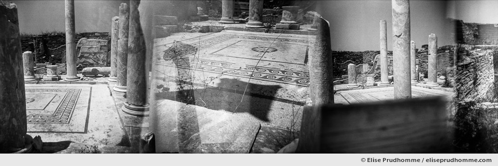 Black and white photograph of the ruins of Delos, Greece. Analog photography series entitled Lieux-dits by Elise Prudhomme.