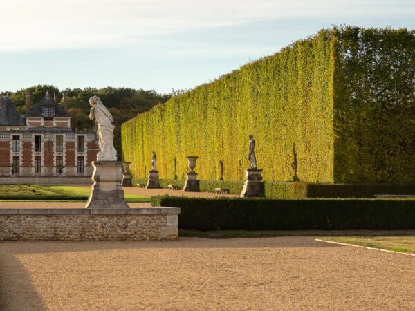 Bordering grove and 17th sculptures, Chateau du Champ de Bataille, Normandy, France