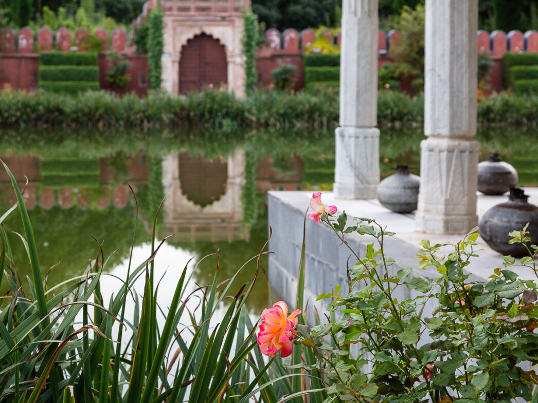 Rose and reflection in the Palace of Dreams reconstructed from an Indian palace, Chateau du Champ de Bataille, France