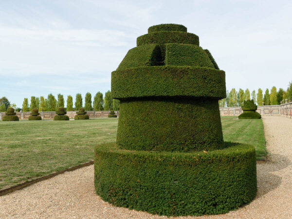 Topiary garden at the Chateau du Champ de Bataille, Normandy, France, designed to represent a game of chess. This chess piece is the castle, or rook.