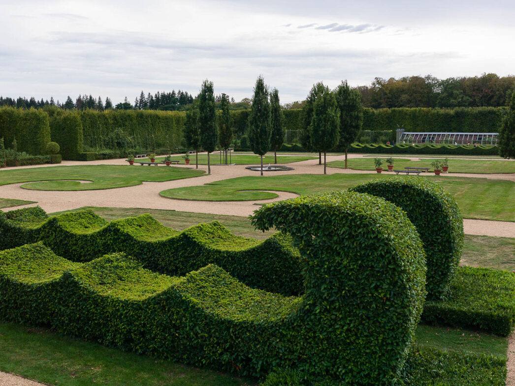 Topiary sculpture in the form of a wave at the Château du Champ de Bataille, Normandy, France.