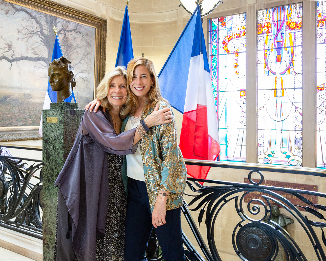 The bride and her mother stand in front of the French flag after the civil ceremony of mariage at the Mairie de Vichy, France.