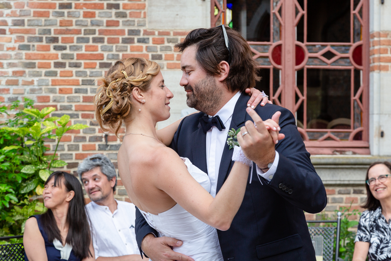 The bride and groom enjoy the first dance during their Wedding Party Chateau de Maulmont near Vichy, France.