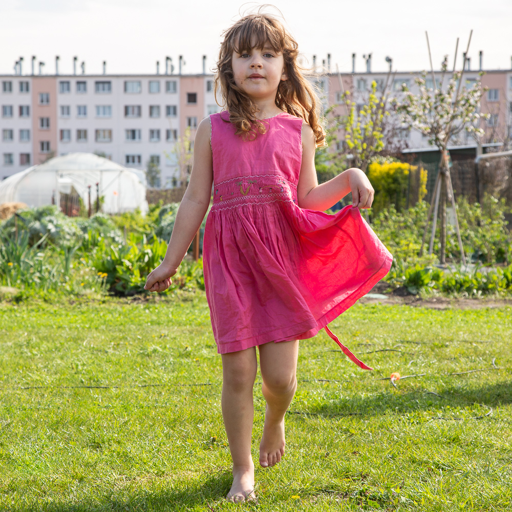 A young girl playing in the garden at the Sensitive Zone during a presentation by guest speaker Gilles Clement at the Sensitive Zone - Urban Farm of Saint-Denis on 9 April 2019.