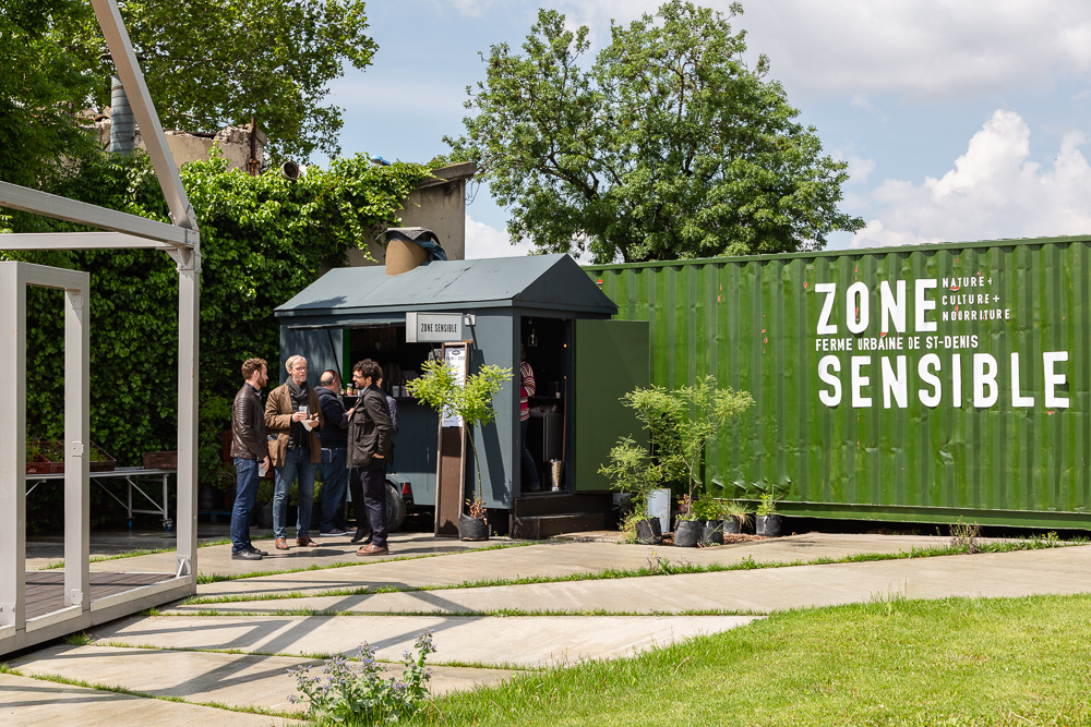 Entrance to the Sensitive Zone project and bar - teahouse - kiosk, Seine-Saint-Denis.  L'inauguration de la Ferme Urbaine de Saint-Denis le 11 mai 2019.  Zone Sensible / Parti Poétique et la Ferme Ouverte de Saint-Denis.