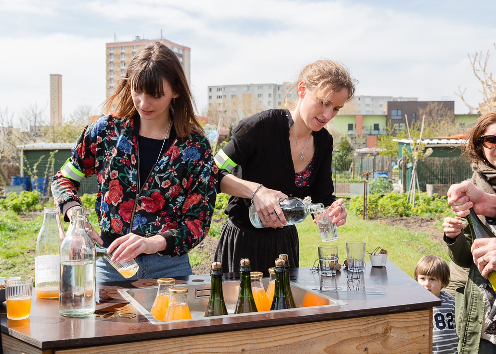 Mona and Alice Prudhomme serving farm fresh cider at the Sensitive Zone - Urban Farm of Saint-Denis on 9 April 2019.