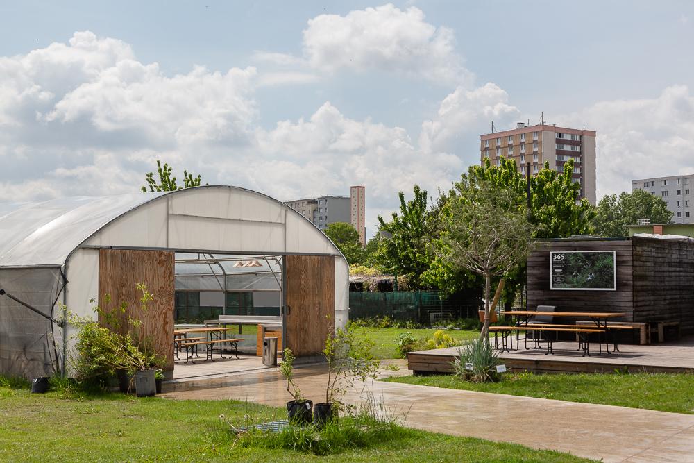 Overview of the greenhouse and public areas of the Sensitive Zone, Seine-Saint-Denis.  L'inauguration de la Ferme Urbaine de Saint-Denis le 11 mai 2019.  Zone Sensible / Parti Poétique et la Ferme Ouverte de Saint-Denis.