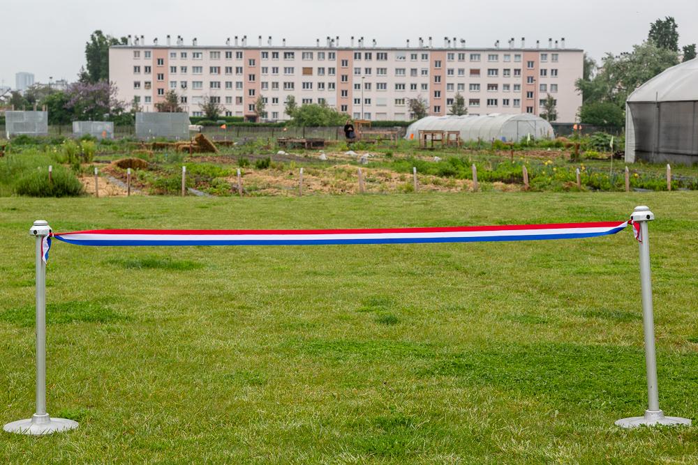 Setting up the ribbon before the inauguration of the Urban Farm of Saint-Denis on 11 May 2019. Inauguration de la Ferme Urbaine de Saint-Denis le 11 mai 2019.  Zone Sensible / Parti Poétique et la Ferme Ouverte de Saint-Denis.