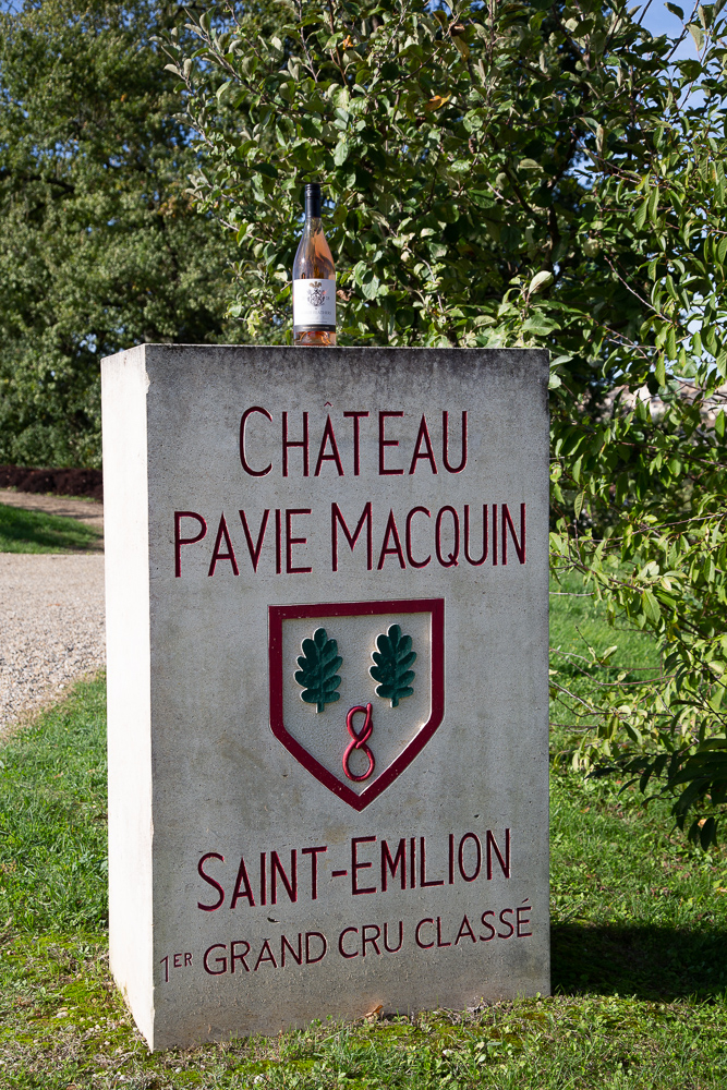 A bottle of Three Feathers Estate Blanc de Noirs perched on the stele of Chateau-Pavie-Macquin, Saint-Emilion, Gironde, France.