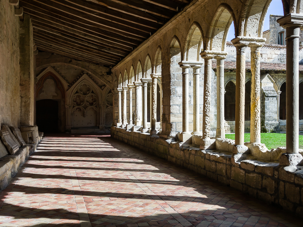 Interior cloister, columns and walls of the Eglise Collegiale in Saint-Emilion, Bordeaux region, Department of the Gironde, France.