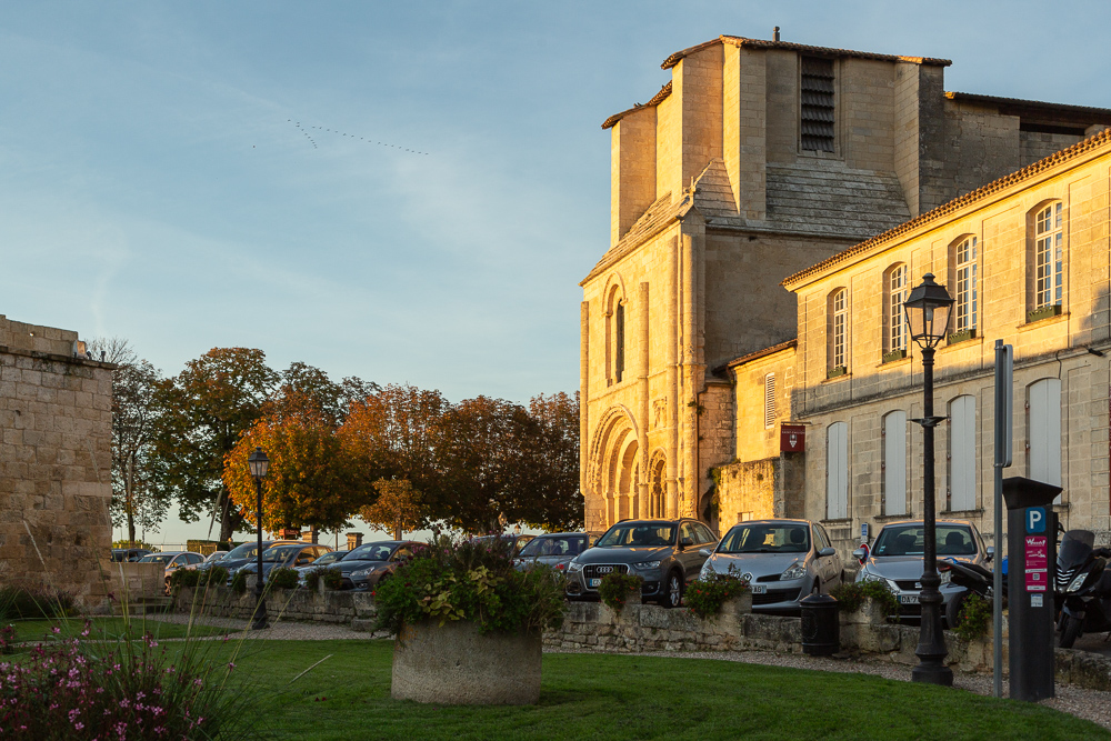 Autumnal facade of the Collegiale Church of Saint-Emilion just before sunset, Bordeaux, Department of the Gironde, France.