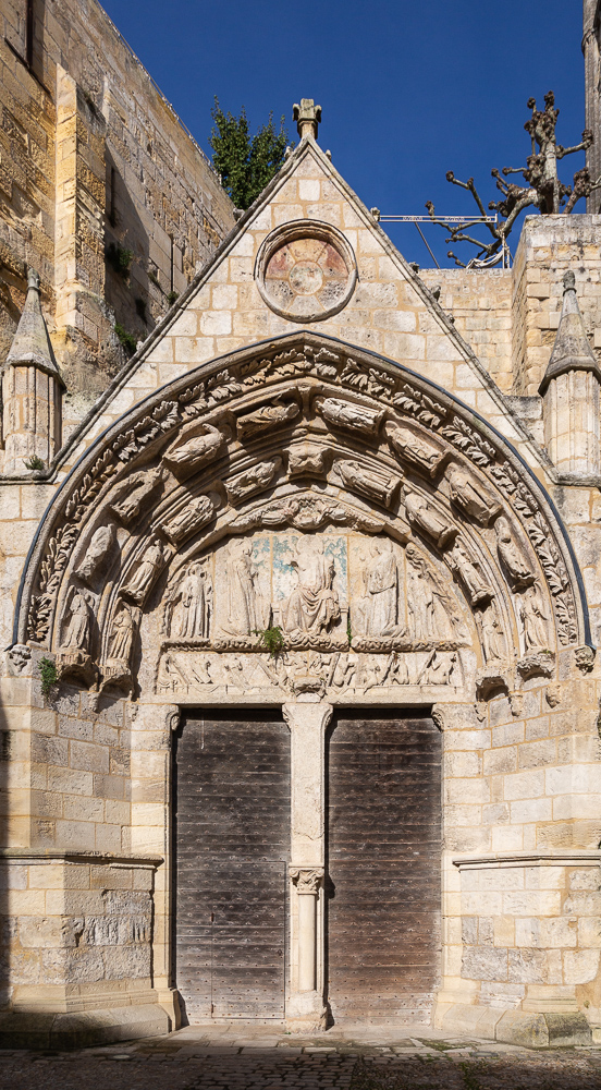 Doors and portico marking the entrance to the rock-carved sanctuary, or Monolith, carved out in the 11th century, Place du Marche, Saint-Emilion, Gironde, France.
