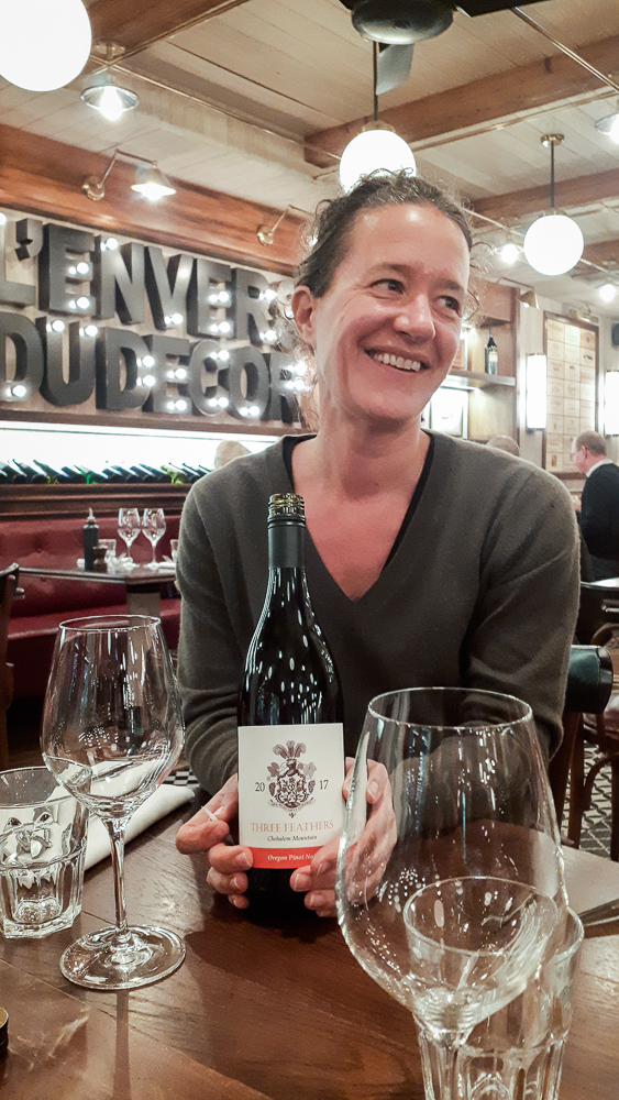 Elise Prudhomme with a bottle of 2017 Three Feathers Pinot Noir at L'Envers du Decor, Saint-Emilion, Gironde, France.