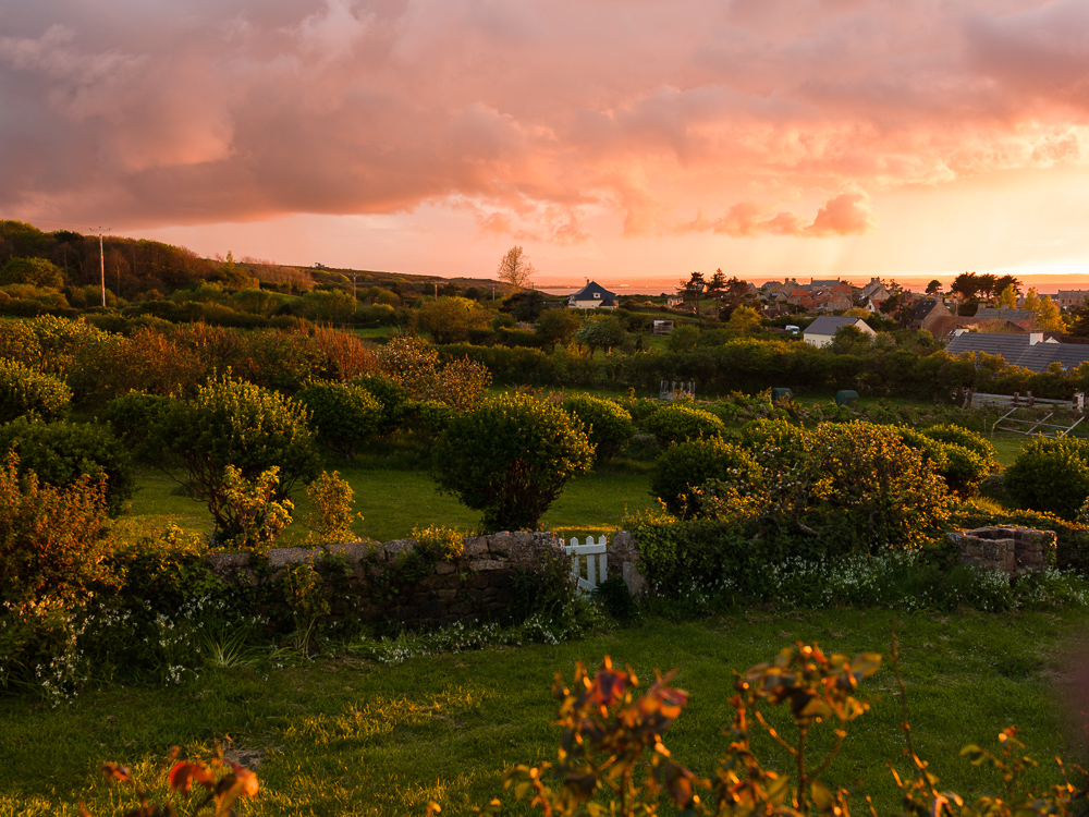 Sunset over Normand bocage with the distant English Channel in the town of Fermanville, Cotentin Peninsula, Normandy, France.