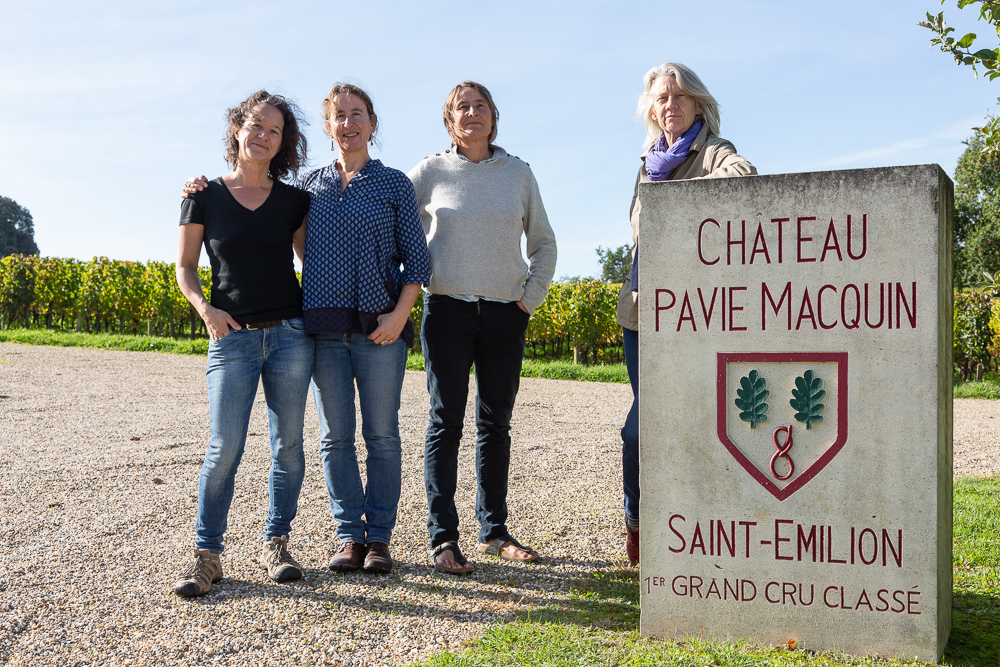 Group portrait next to the stele of Chateau-Pavie-Macquin, Saint-Emilion, Gironde, France.