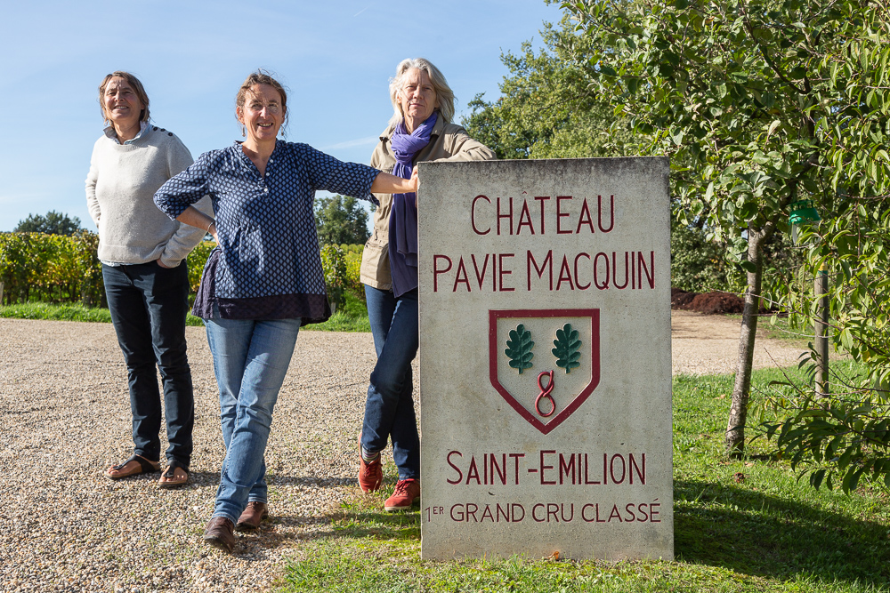 Group portrait next to the stele of Chateau-Pavie-Macquin, Saint-Emilion, Bordeaux region, Department of the Gironde, France.