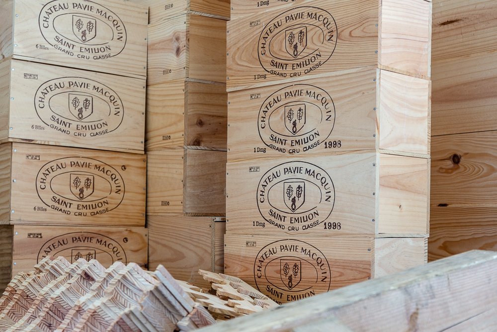 Wooden shipping boxes in stock for delivery at Wine Estate Château Pavie Macquin, Saint Émilion, Department of the Gironde, France.